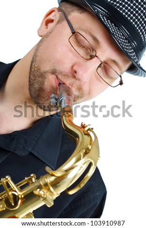 Closeup of a young man with glasses and hat, eyes closed, playing the saxophone -isolated on white - stock photo