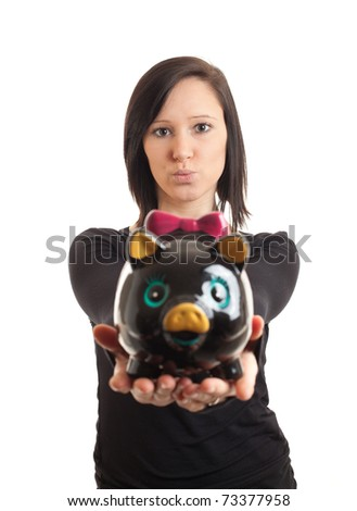 closeup of a young woman presenting a piggy bank to the camera - stock photo