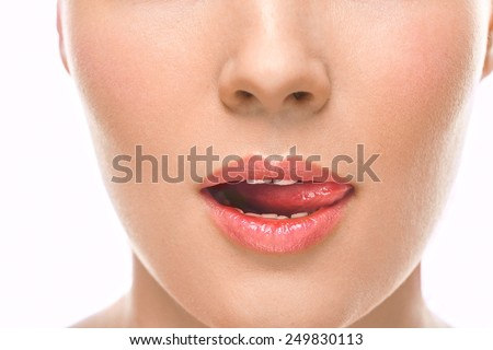 Closeup of a young woman's mouth and tongue - stock photo