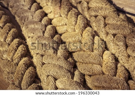 Closeup of aged vintage marine ropes on old sailing vessel. Shallow depth of field. - stock photo