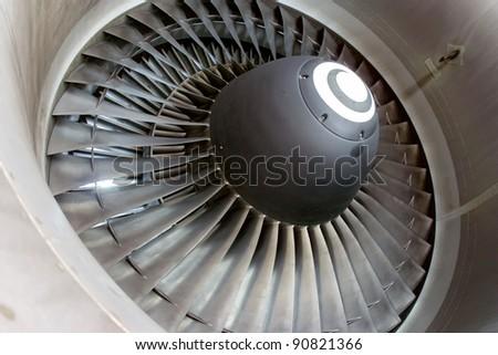 Closeup of aircraft jet engine at the hangar. - stock photo