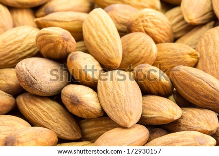 Closeup of almond nuts as a background - stock photo