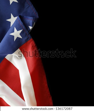 Closeup of American flag on black background - stock photo