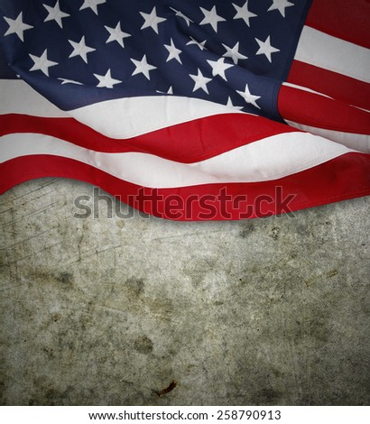 Closeup of American flag on concrete background - stock photo