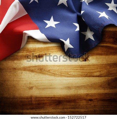 Closeup of American flag on wood background - stock photo