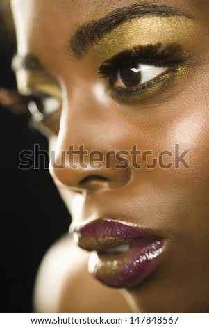 Closeup of an African American woman with highfashion makeup - stock photo