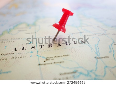 Closeup of an Australia map with red tack                                - stock photo