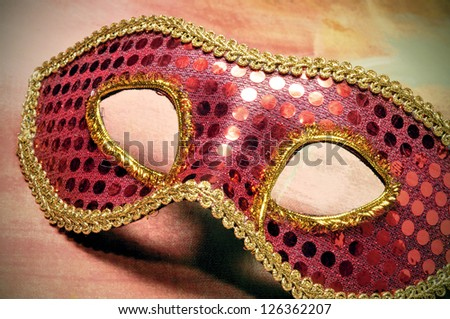 closeup of an elegant red and golden carnival mask - stock photo