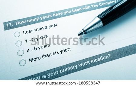 Closeup of an employee opinion survey and pen                                - stock photo