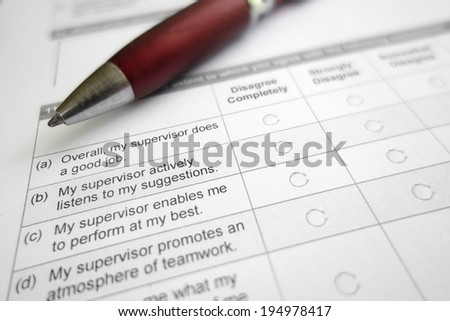 Closeup of an employee work survey - supervisor  related                               - stock photo