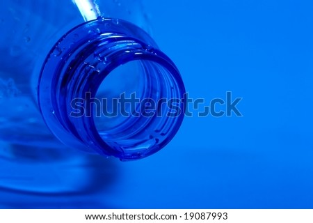 Closeup of an empty, open water bottle - stock photo