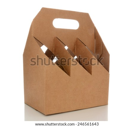 Closeup of an empty six pack carrier. The cardboard carrier is blank and isolated on white with reflection. - stock photo