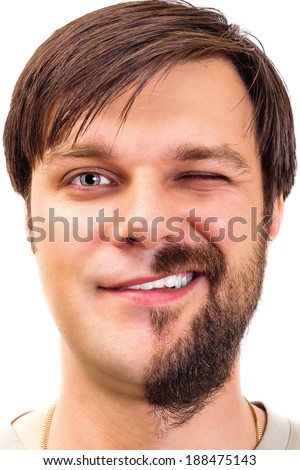 Closeup of an expressive young man with  beard on half of the face on white background - stock photo