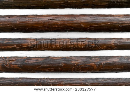 Closeup of an Exterior Log Cabin Wall with Chinking - stock photo