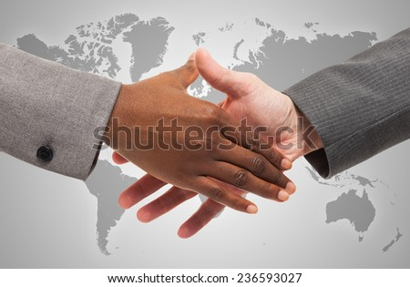 Closeup of an handshake between business people of different ethnicity - stock photo