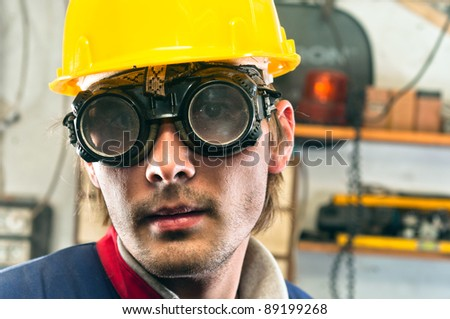 Closeup of an industrial worker in yellow helmet - stock photo