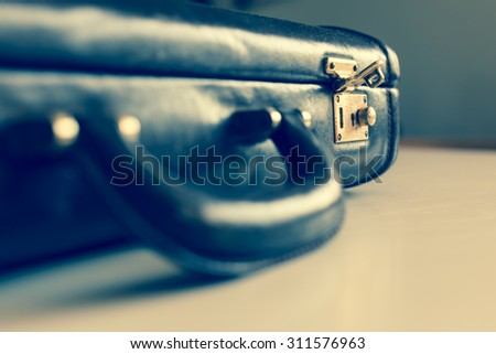 closeup of an old brown shabby brief case being opened . - stock photo