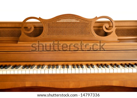 Closeup of an old console piano. Upper portion isolated on white. Would work well for a grunge project. - stock photo