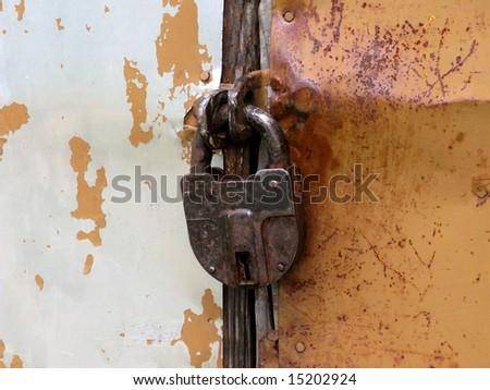 Closeup of an old padlock - stock photo