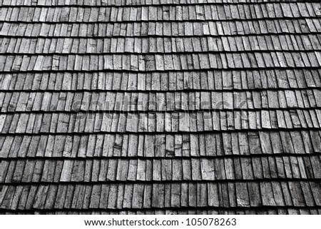 Closeup of an old roof with grey wooden tiles - stock photo