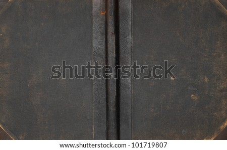 Closeup of antique leather book cover. - stock photo