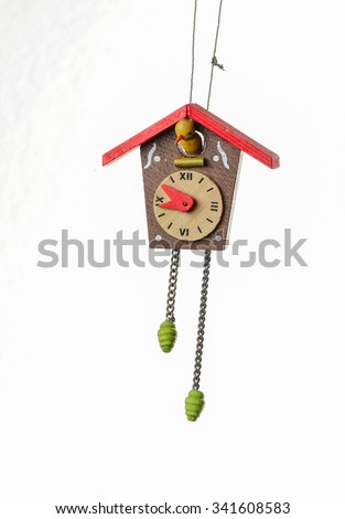 Closeup of antique wooden cuckoo clock Christmas Tree Ornament isolated on white. - stock photo