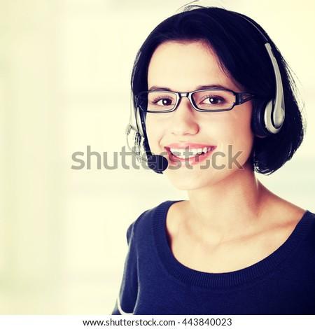 Closeup of attractive customer support representative - stock photo