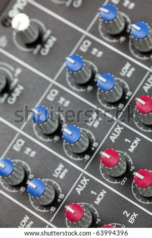 Closeup of audio mixing console. Shallow depth of field. Studio work. - stock photo