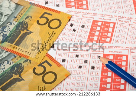 Closeup of Aussie money and sports betting slip  - stock photo