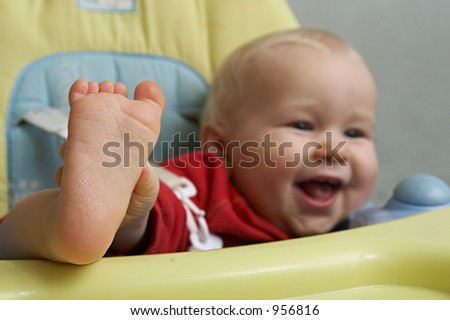 closeup of baby foot on the table - stock photo