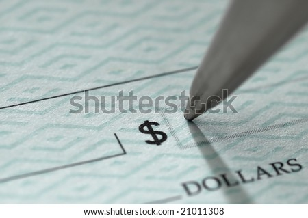 Closeup of ballpoint pen writing on a blank bank check, ready to fill in the dollar amount; selective focus on the tip of the pen, very shallow DOF - stock photo