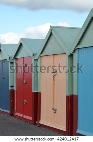 Closeup of beach huts - stock photo