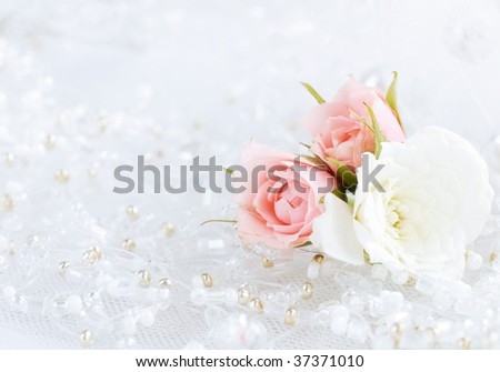 Closeup of beads with small flowers - stock photo