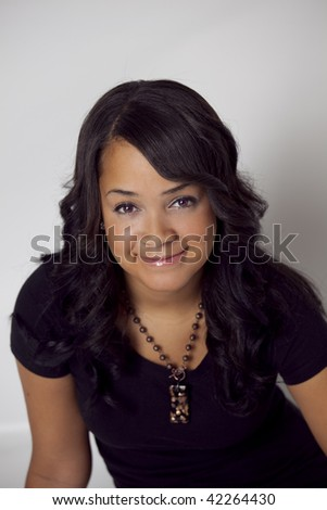 closeup of beautiful african american woman wearing black - stock photo