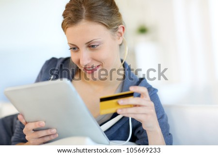 Closeup of beautiful blond girl doing online shopping - stock photo