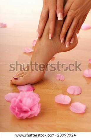 closeup of beautiful human legs and hands.  human feet. SPA and wellness - stock photo