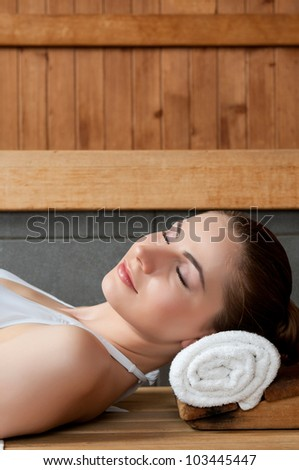 Closeup of beautiful lady relaxing at sauna in a spa center - stock photo