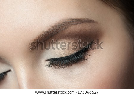 Closeup of beautiful woman eye with makeup, closed eyes - stock photo