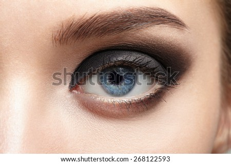 Closeup of beautiful woman eye with makeup, eyeliner. - stock photo