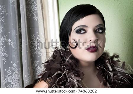 Closeup of beautiful woman wearing feather boa - stock photo