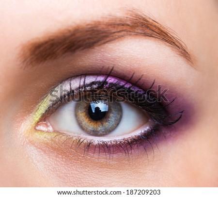 Closeup of beautiful womanish eye with glamorous makeup - stock photo