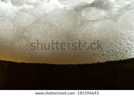 Closeup of beer foam - stock photo