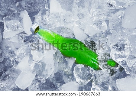 Closeup of beer sink on ice cube - stock photo