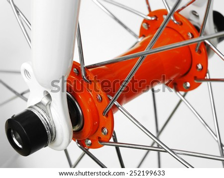 Closeup of bicycle hub and spokes. - stock photo