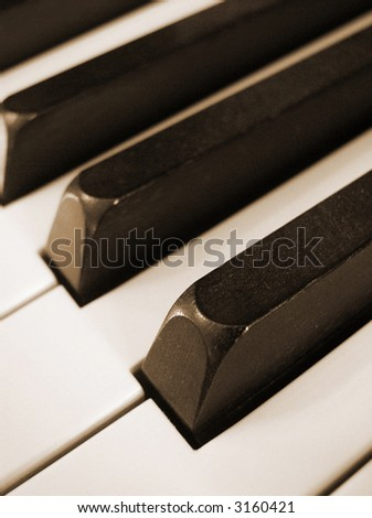 closeup of black and white piano keys, vertical orientation - stock photo