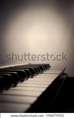 Closeup of black and white piano keys with sepia  - stock photo