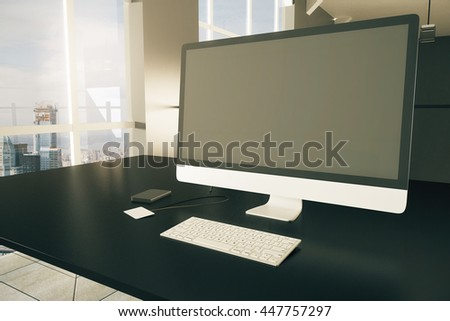 Closeup of black desktop with blank computer monitor, keyboard, smartphone and blank badge on window with city view background. Mock up, 3D Rendering - stock photo