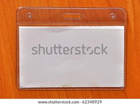 closeup of blank badge on wood background - stock photo