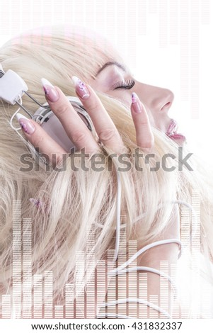 closeup of blonde young woman listening to music in headphones  - stock photo