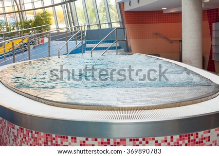 Closeup of blood bubbling whirlpool tubs. (Shallow DOF). - stock photo